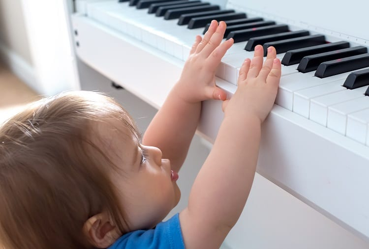 Baby Trying To Reach Piano Keyboard
