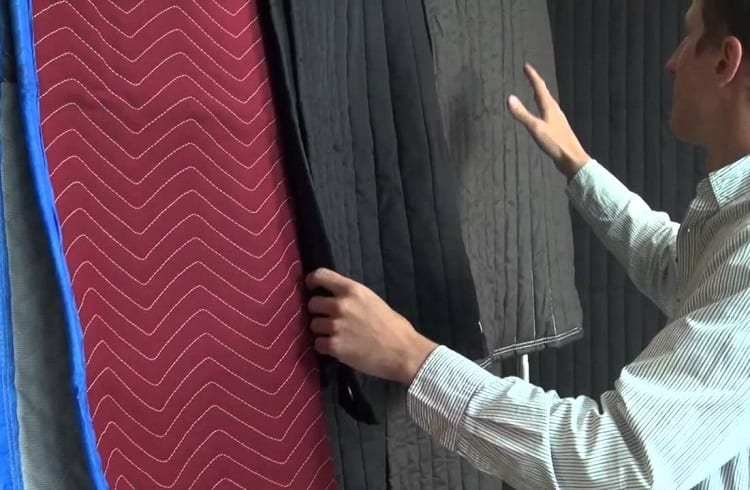 Man Choosing Soundproof Curtains